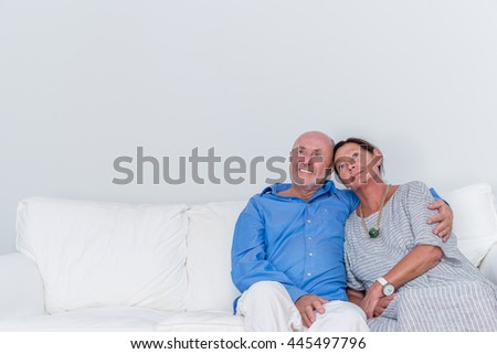 sitting embraced grandparents thinking