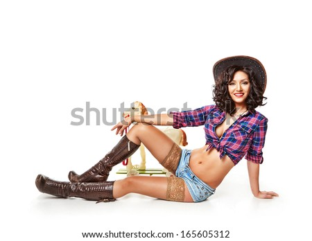 Sitting girl and toy horse - stock photo