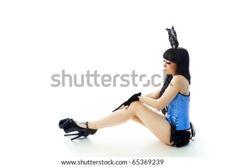 Sitting girl in suit of rabbit - stock photo