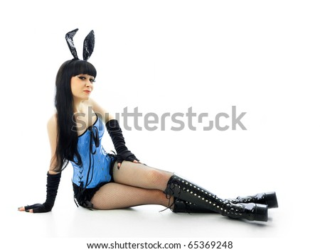 Sitting girl with hare ears - stock photo