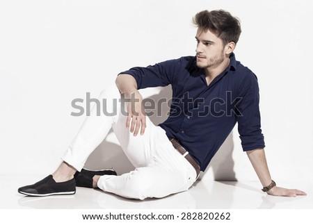 Sitting handsome man - stock photo