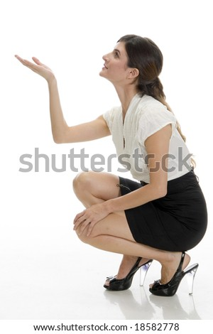 sitting lady looking upside on an isolated background - stock photo