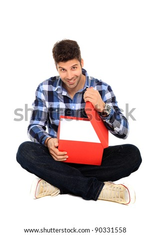 sitting man opens a red gift box
