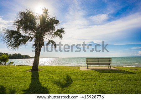 Sitting on a bench looking out to sea - Darwin, Australia   - stock photo