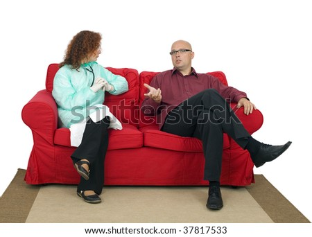 sitting on red sofa speaking with lady doctor man - stock photo