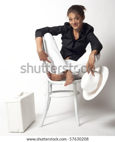 sitting on white chair