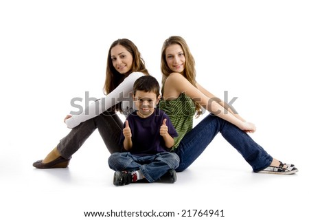 sitting siblings with thumbs up on an isolated background - stock photo