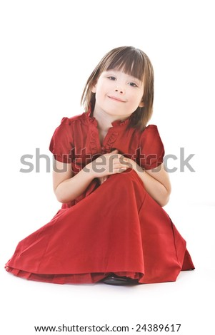 Sitting small girl in red dress - stock photo