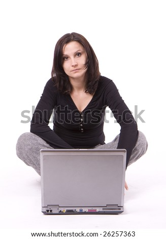 sitting squat woman working on laptop looking at camera