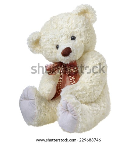 Sitting teddy bear isolated on white - stock photo
