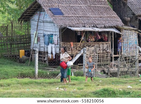Sittwe - October 25, 2016: Traditional housing with straw roof at the outskirts of Sittwe, the Rakhine State, Myanmar, a state with little development but with endless ethnic and religious conflicts.