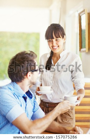 situation in office - woman sharing tea with man - stock photo