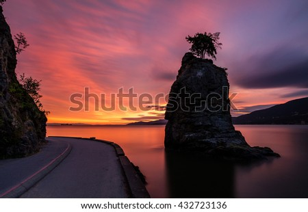 Siwash Rock at sunset Along the Sea Wall in Stanley park, Vancouver, British Columbia, Canada. - stock photo