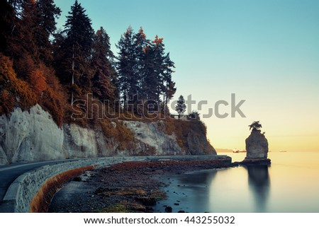 Siwash Rock in Stanley Park at sunrise in Vancouver - stock photo