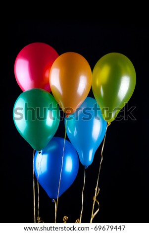 Six balloons on black background - stock photo