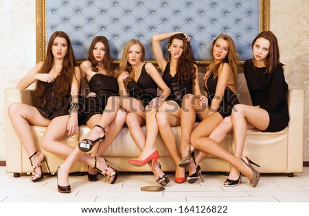Six beautiful sexy models are sitting on the sofa
