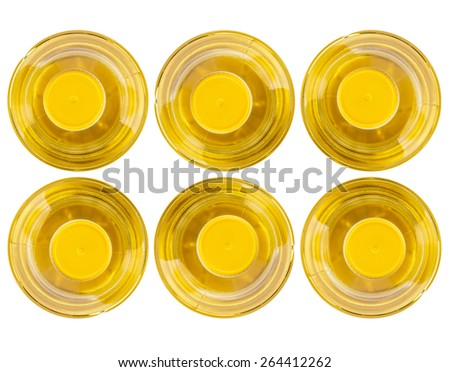 Six bottle of vegetable oil, top view. Isolated on white background
