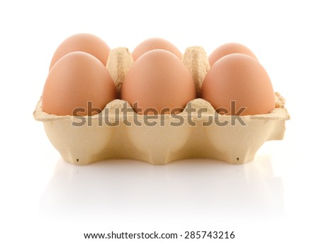 Six brown eggs in carton on white with clipping path - stock photo