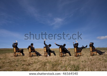 Six businessman relaxing at the field