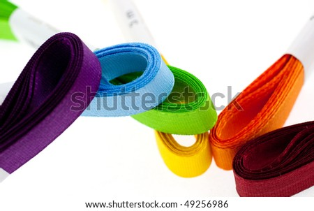 six colored ribbons on white background. closeup