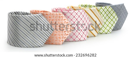 six colored ties on white background  - stock photo