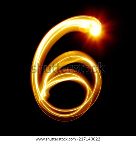 Six - Created by light numerals over black background - stock photo