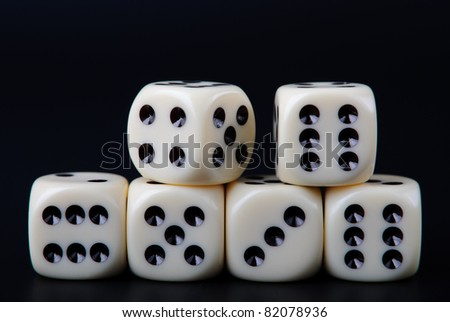 Six dices stacked on two rows on black background - stock photo