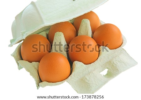 six eggs in a paper container - stock photo