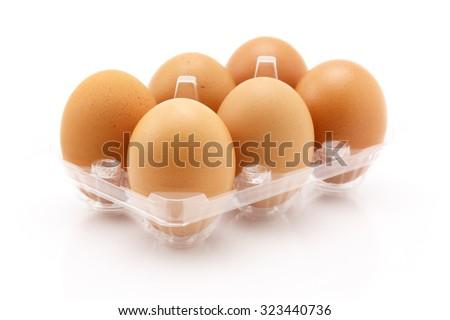Six eggs isolated on white background, close up shot - stock photo