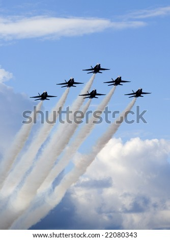 Six F/A 18 jets of the U.S. Navy's Blue Angels fly in close formation in a blue sky over Hawaii