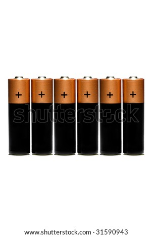 Six finger-type alkaline batteries on white background - stock photo