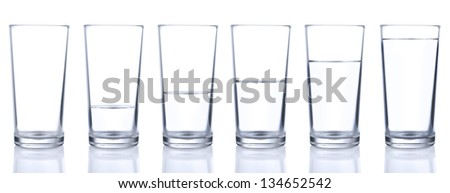 Six glasses with cold still water isolated on white background - stock photo