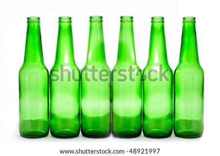 six green bottles isolated on white