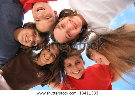 Six Kids Laughing Outdoors in the Sunshine