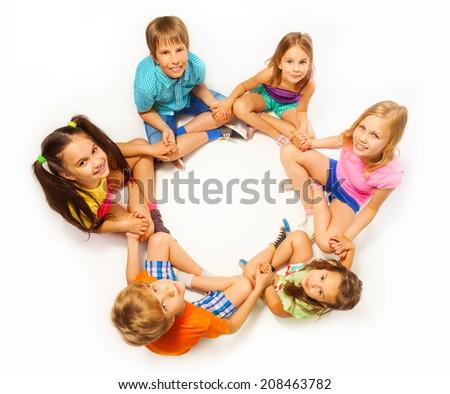 Six kids sit in a lotus pose - stock photo
