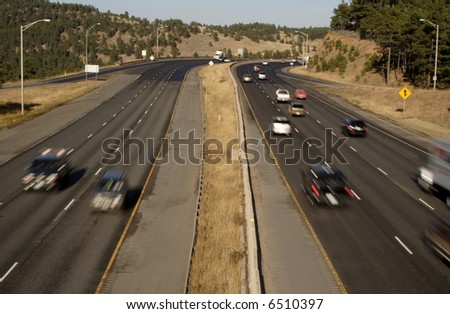 six lanes of blurred traffic - stock photo
