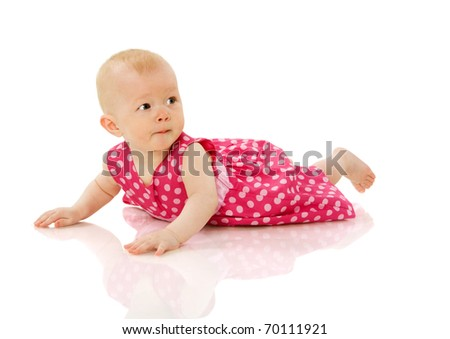 Six month girl lying on floor isolated on white