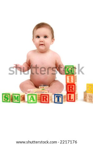 six month old baby girl with blocks