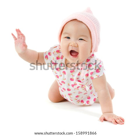 Six months old Asian baby girl crawling over white background, isolated. - stock photo