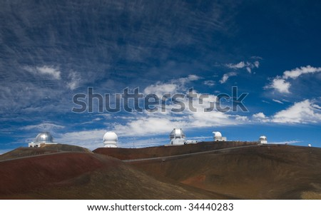 Six observatories standing atop of the Mauna Kea volcano in Hawaii Big Island. - stock photo