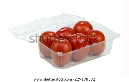 Six Red Tomatoes In Plastic Retail Supermarket Packaging isolated on white background  - stock photo