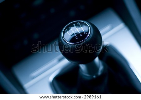 Six speed gear shifter in sports car. Manual transmission detail. - stock photo