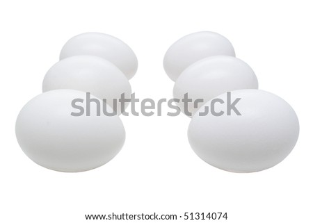 Six white eggs in two rows one against another isolated on white background