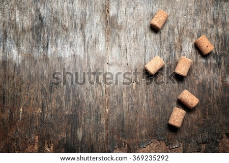 Six wine corks on old wooden background - stock photo