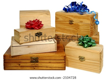 six wooden boxes with bows on white background - stock photo