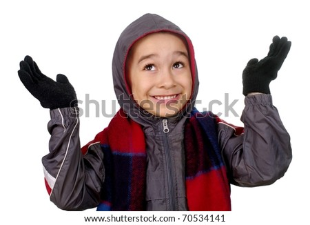 Six year old boy in winter clothes looking up smiling, hands raised, isolated on pure white background - stock photo