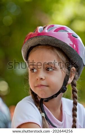 Six year old girl wearing a bike helmet - stock photo