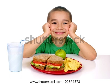 six year old Hispanic boy ready to eat a sandwich meal, shot on white background