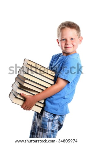 Six years old boy holding a pile of books. Isolated on white. - stock photo