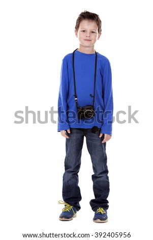 six years old boy taking photos with his camera on white background - stock photo